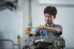 Man are repairing car. Engine at garage Royalty Free Stock Photo
