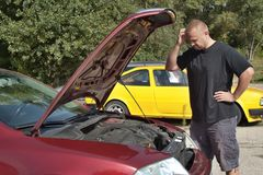 Man repairing the car Stock Images