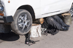 Man repairing a car Stock Photography