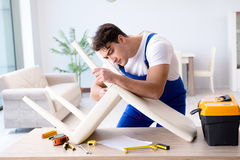 The man repairing chair in the room Stock Photo