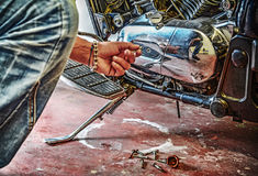 Man repairing a classic motorcycle Stock Photo