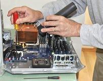 Man repairing computer Stock Photos