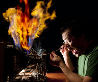 Man repairing computer on fire Stock Photos