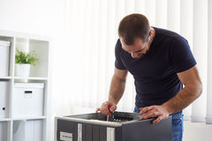 Man repairing computer in the office Royalty Free Stock Photo