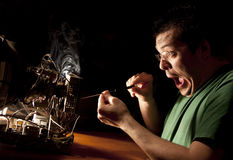 Man Repairing Computer On Fire Royalty Free Stock Image