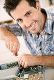 Man repairing computer with screwdriver Stock Images