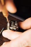Man repairing e-evaporator. Maintenance of electronic mech mod vaping device.Modern vaporizer e-cig gadget to vape glycerin e-liquid.Vaper device repair service stock images