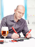 Man repairing an electronic device Stock Photos