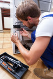 Man repairing fridge at home Stock Photo