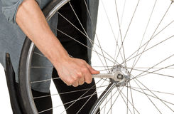 Man repairing front wheel on a bicycle Stock Photography