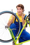 The man repairing his bike isolated on white background royalty free stock photos