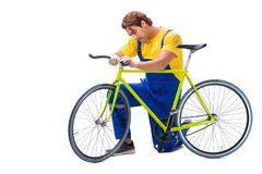 The man repairing his bike isolated on white background royalty free stock photography