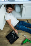 Man repairing a kitchen sink Royalty Free Stock Images