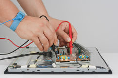 Man repairing LCD Monitor Royalty Free Stock Photography
