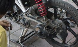 Man repairing a motocycle Stock Image