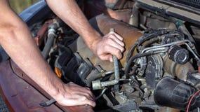 Man repairing motor block Royalty Free Stock Photography