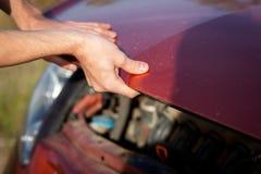 Man repairing motor block Stock Image
