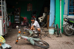 Man Repairing A Motorbike Stock Image