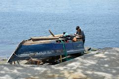 Man repairing an old boat Royalty Free Stock Image