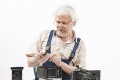 Man repairing an old camera Royalty Free Stock Photography