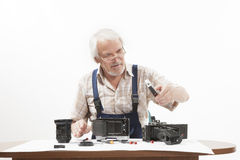 Man repairing an old camera Stock Photography
