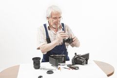 Man repairing an old camera Royalty Free Stock Images