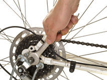 Man repairing rear wheel on a bicycle Royalty Free Stock Images