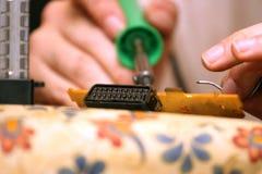 Man repairing scart Royalty Free Stock Image