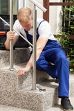 Man repairing a stair railing Royalty Free Stock Photos