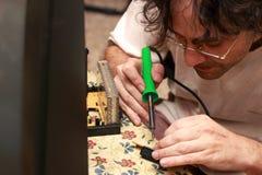 Man repairing television. Close up of a Man repairing an old Tv stock image