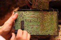 Man repairing television Royalty Free Stock Image