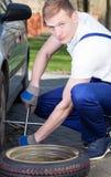 Man repairing a tire Royalty Free Stock Photos
