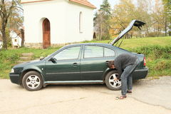 Man repairing wheal of car Royalty Free Stock Photos