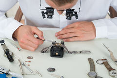 Man Repairing Wrist Watch Royalty Free Stock Images