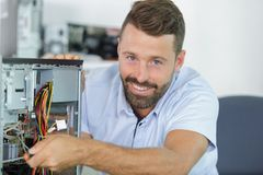 Free Man Repairman Trying To Fix Pc Royalty Free Stock Photos - 162598458