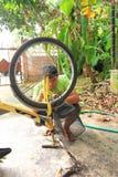 Man Repairs Bicycle Stock Image