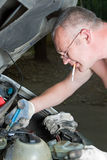 The man repairs car Stock Images