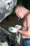 The man repairs car Stock Photography