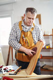Man repairs a chair in his workshop Stock Image