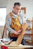 Man repairs a chair in his workshop Royalty Free Stock Image