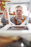 Man repairs a chair in his workshop Royalty Free Stock Photography
