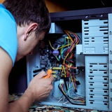 Man repairs the computer Royalty Free Stock Image