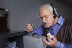 A man repairs the safe Stock Photo