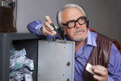 A man repairs the safe Stock Image