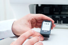 Man replace black ink cartridge. Stock Images