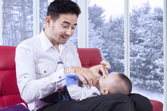 Man replace his baby clothes Royalty Free Stock Photos