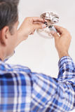 Man Replacing Battery In Home Smoke Alarm Stock Images