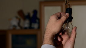 Man replacing the incandescent bulb burned out stock video