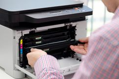 Man replacing toner in laser printer. Toner printer cartridge print laser office supplies refill concept Stock Photos