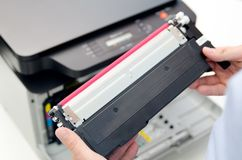 Man replacing toner in laser printer Stock Photos